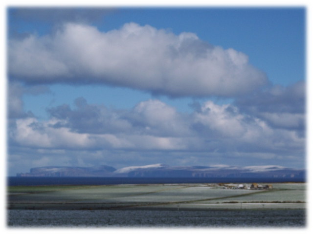 Dunnet Head and the Orkney Islands covered in snow