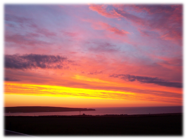 Thurso Bay, with the sun setting behind Holborn Head